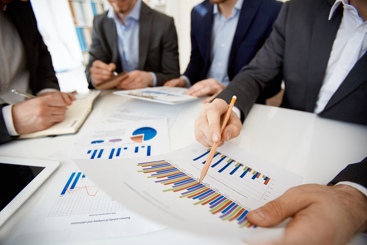 Businessman explaining financial results in chart